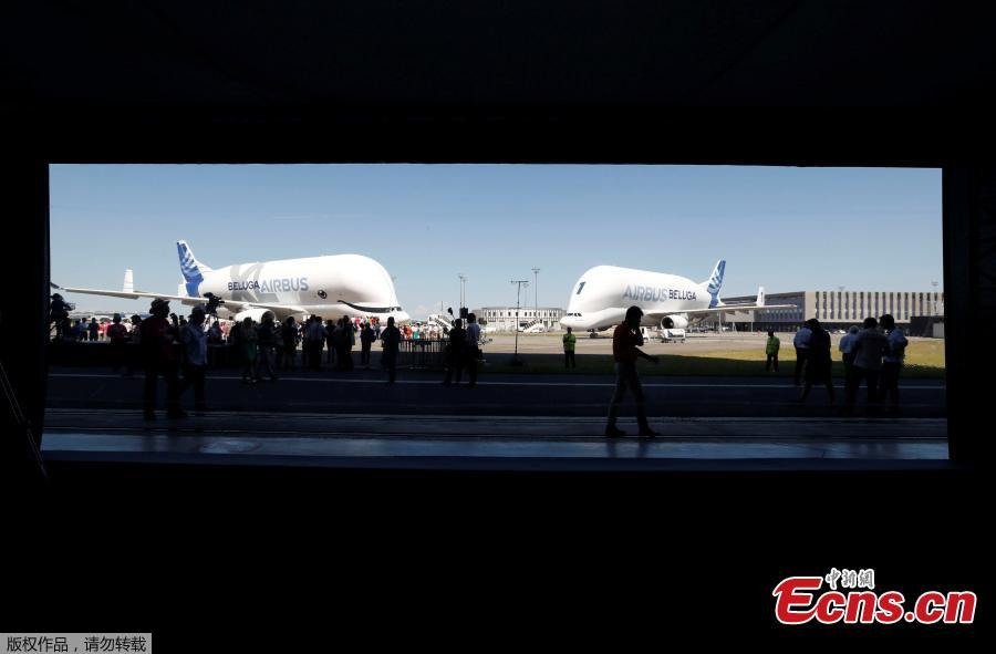 An Airbus Beluga XL transport plane (L), near an Airbus Beluga ST (R), is seen on the tarmac after its first flight event in Colomiers near Toulouse, France, July 19, 2018. (Photo/Agencies)