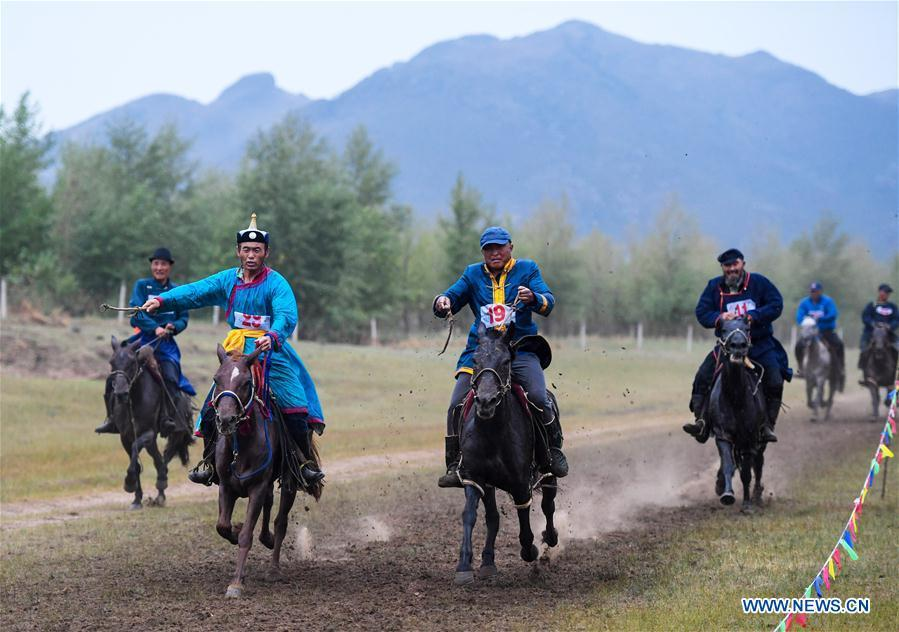 Herdsmen compete in a horse race during a Nadam fair in Chifeng City, north China\'s Inner Mongolia Autonomous Region, July 20, 2018. Nadam Fair, meaning \