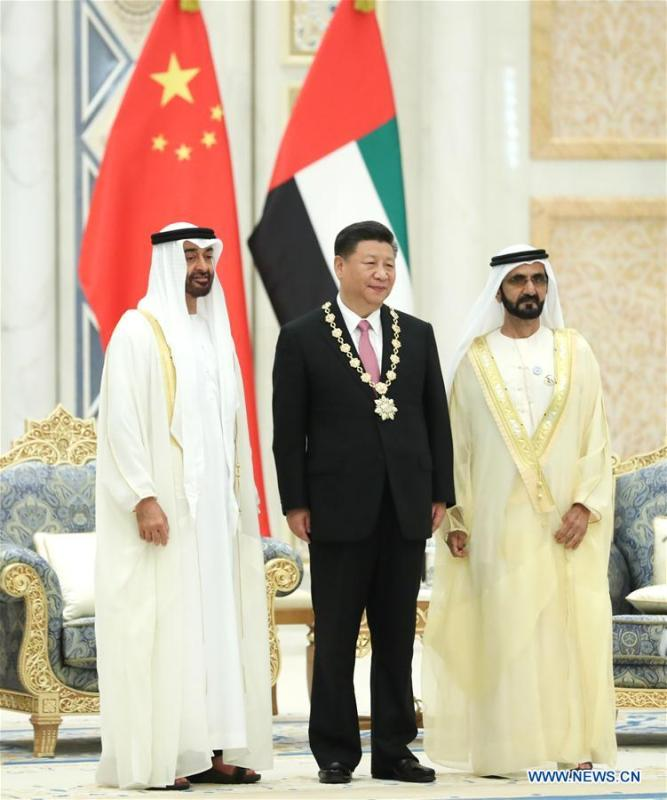 Chinese President Xi Jinping is conferred with the Order of Zayed, the UAE\'s highest civil decoration after talks with UAE Vice President and Prime Minister Sheikh Mohammed bin Rashid Al Maktoum and Crown Prince of Abu Dhabi Sheikh Mohammed bin Zayed Al Nahyan in Abu Dhabi, the United Arab Emirates (UAE), July 20, 2018. Xi arrived here on Thursday for a state visit to the UAE. (Xinhua/Pang Xinglei)