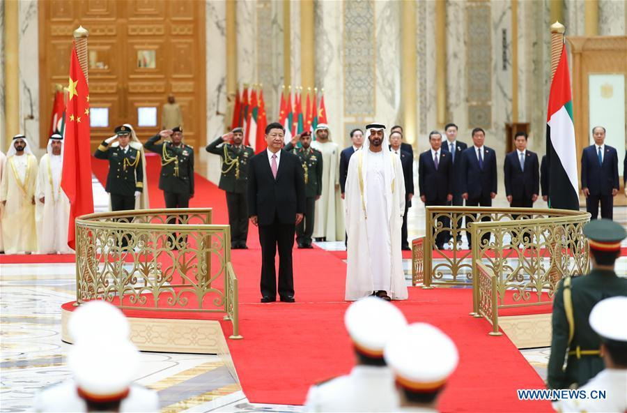 Chinese President Xi Jinping and Crown Prince of Abu Dhabi Sheikh Mohammed bin Zayed Al Nahyan attend a grand welcome ceremony in Abu Dhabi, the United Arab Emirates (UAE), July 20, 2018. Xi arrived here on Thursday for a state visit to the UAE. (Xinhua/Xie Huanchi)