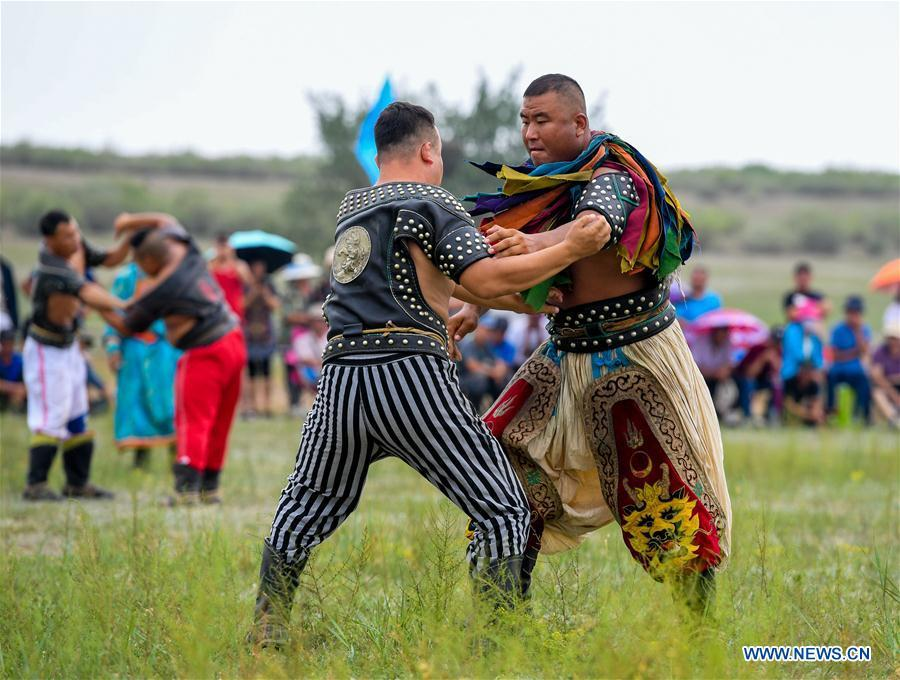 Two wrestlers compete during a Nadam fair in Chifeng City, north China\'s Inner Mongolia Autonomous Region, July 20, 2018. Nadam Fair, meaning \