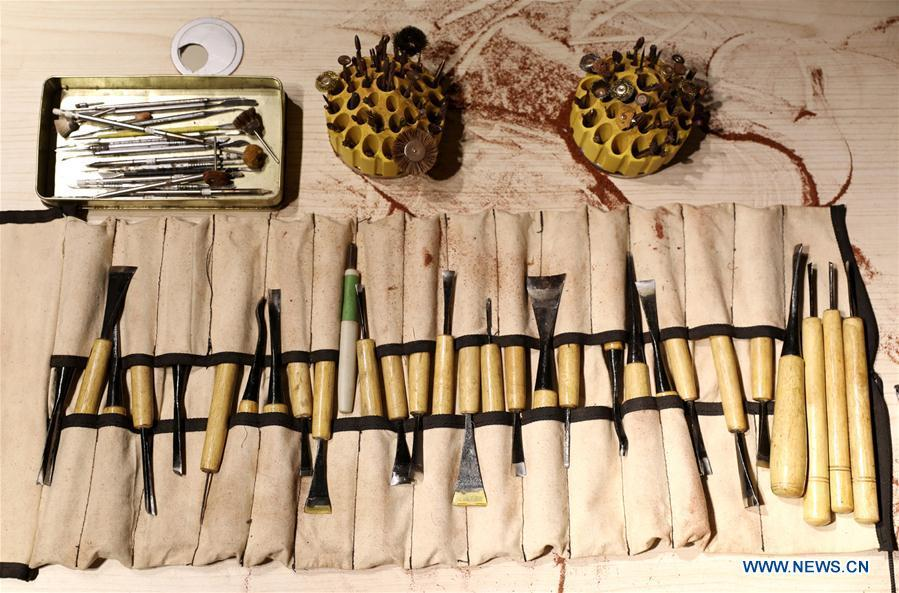 Photo taken on July 20, 2018 shows the tools used by wood carving craftsman Guo Dong in Shijiazhuang, capital of north China\'s Hebei Province. The \