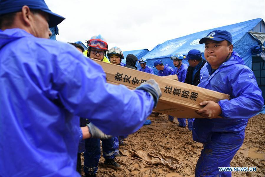 Rescuers convey disaster relief materials at flood-hit Chenhe Village of Dongxiang Autonomous County in Linxia Hui Autonomous Prefecture, northwest China\'s Gansu Province, July 20, 2018. About 1.08 million people in Gansu Province were affected by rain-triggered floods, with 12 deaths, four people missing and 27,000 people evacuated. (Xinhua/Chen Bin)