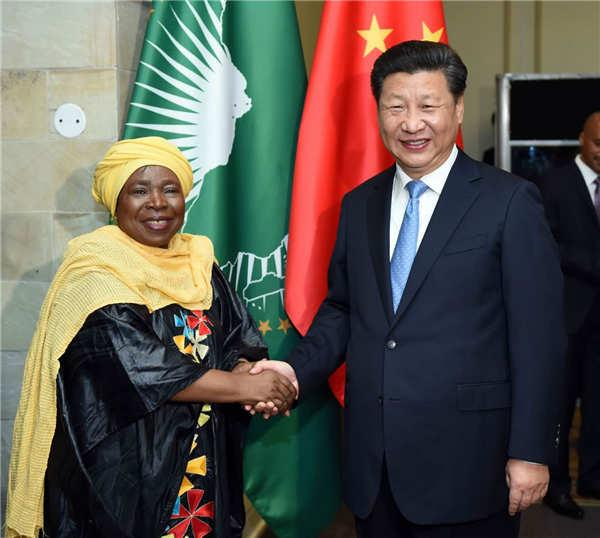 Chinese President Xi Jinping, right, meets with African Union Commission Chairperson Nkosazana Dlamini-Zuma in Pretoria, South Africa on Dec 3, 2015. (Photo/Xinhua) China has always adhered to the principle of \