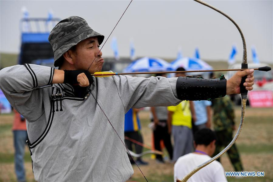 A competitor takes part in an archery contest during a Nadam fair in Chifeng City, north China\'s Inner Mongolia Autonomous Region, July 20, 2018. Nadam Fair, meaning \