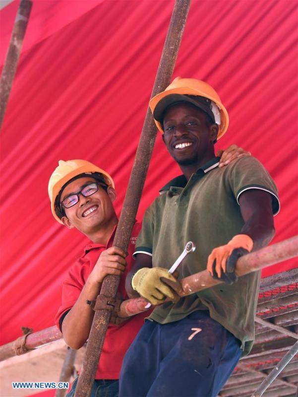 Workers from China and Senegal work in the National Wrestling Arena in Dakar, Senegal, on July 18, 2018. China is now Senegal\'s second largest trading partner and biggest source of financing. The National Grand Theater, the Museum of Black Civilization and the National Wrestling Arena, built with Chinese assistance, stand as important venues to carry forward the culture and traditions of Senegal. (Xinhua/Yan Yan)