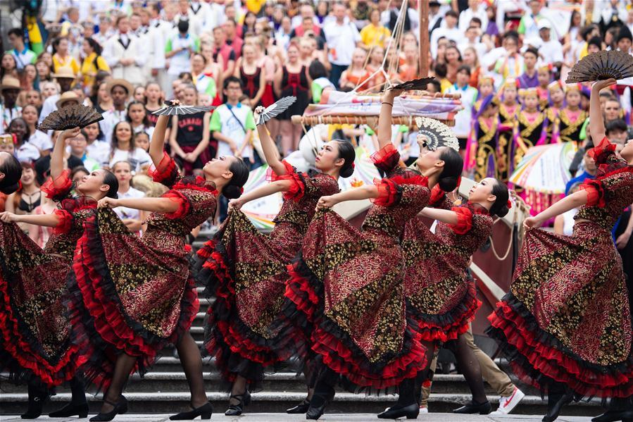 Dancers perform during a parade of an international youth dance festival in Macao, south China, July 21, 2018. A total of 27 dance teams participated in the event here on Saturday. (Xinhua/Cheong Kam Ka)