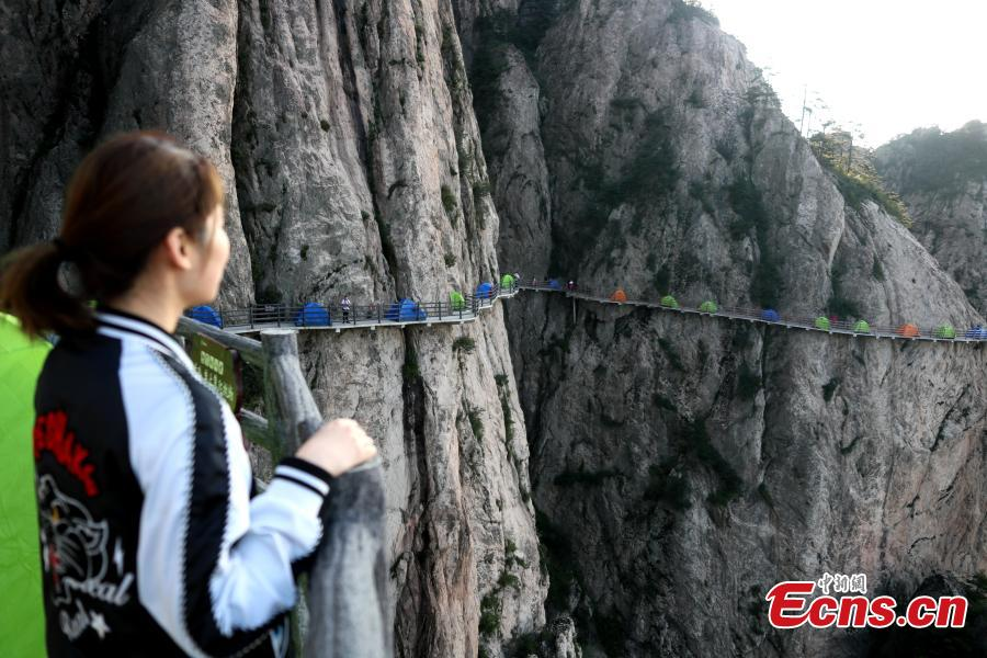 A view of tents perched on a cliff road on Laojun Mountain in Luoyang City, Central China's Henan Province, July 21, 2018. Tourists flocked to the tourist attraction during a camping festival, staying overnight in tents on the cliff road, 2,000 meters above sea level. The mountain is known for its cultural heritage relating to Taoism. (Photo: China News Service/Wang Zhongju)