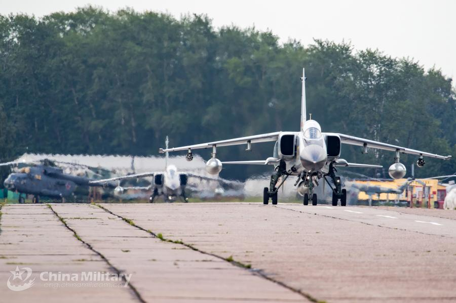 A JH-7A fighter bomber attached to the Chinese PLA Air Force taxies on runway after landing at the airport on July 20. All aircraft of the PLA Air Force to participate in the \