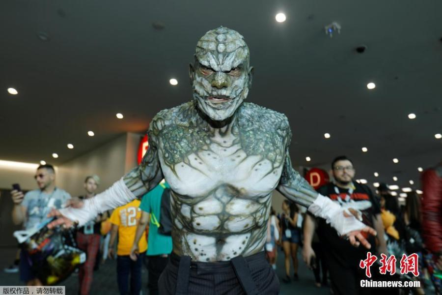 Eli Garcia dressed as the character Killer Croc from the Batman series poses during opening day of pop culture convention Comic-Con in San Diego, California, U.S., July 19, 2018. (Photo/Agencies)