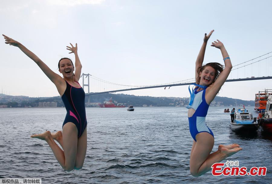 Athletes from Ukraine pose for photographs after they swam in the Bosporus Cross-Continental Swimming Race in Istanbul, July 22, 2018. Over 2,000 open-water competitors plunged into the water from a ferry docked on the city\'s Asian side and swam for about 6.5km in the cross-continental event. (Photo/Agencies)