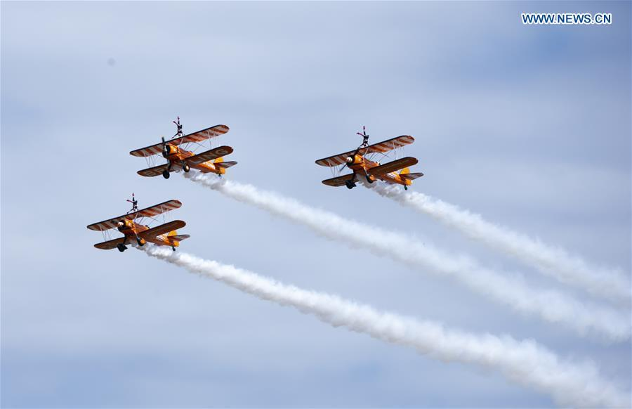 The Breitling Wingwalkers team perform at the Farnborough International Airshow, south west of London, Britain on July 22, 2018. (Xinhua/Han Yan)