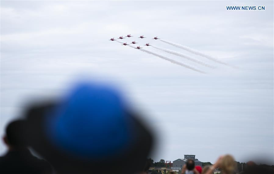 The Red Arrows perform a flypast at the Farnborough International Airshow, south west of London, Britain on July 22, 2018. (Xinhua/Han Yan)