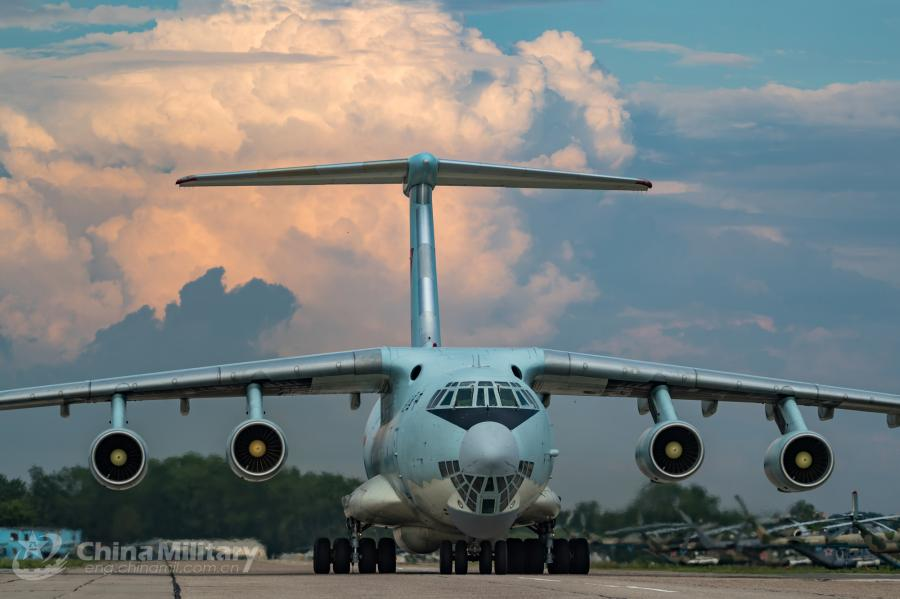 An IL-76 transport aircraft taxies on the runway. A All aircraft of the PLA Air Force to participate in the \