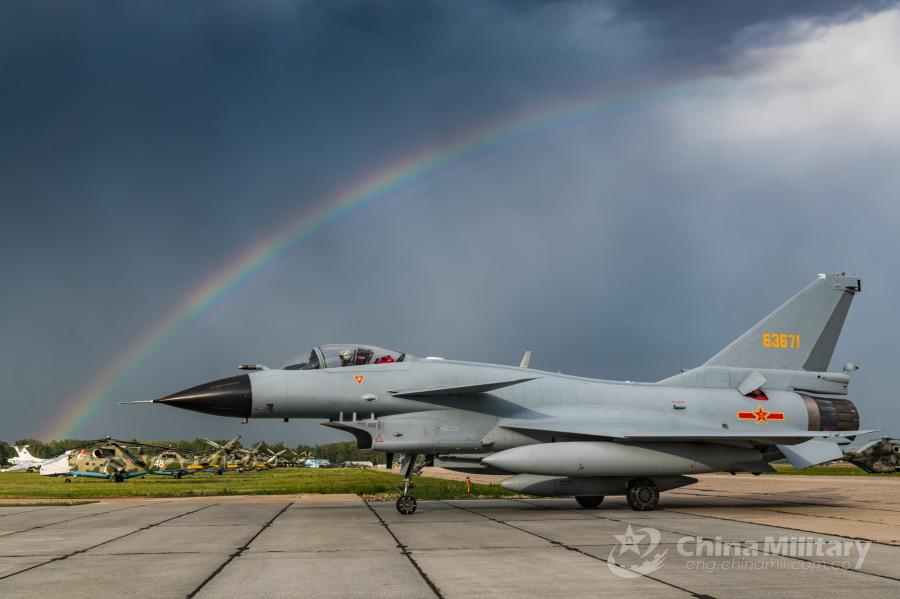 A J-10A fighter jet attached to the Chinese PLA Air Force taxies on runway after landing at the airport on July 21. All aircraft of the PLA Air Force to participate in the \