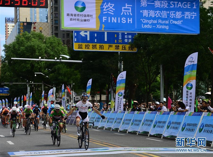 Georgios Bouglas of China\'s Ningxia Sports Lottery Livall Cycling Team (NLC) crosses the finishing line in Xining, Northwest China\'s Qinghai Province, July 22, 2018. (Photo/Xinhua)