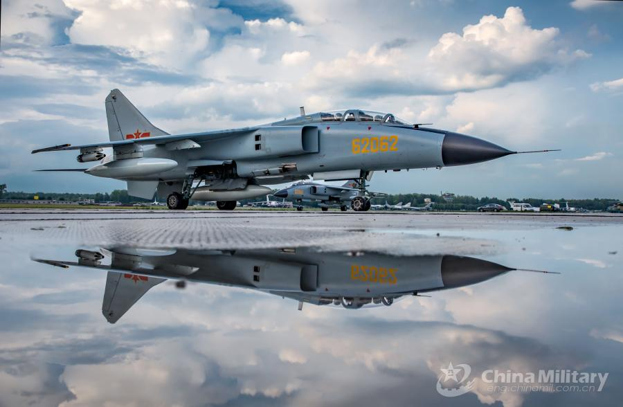 A JH-7A fighter bomber attached to the PLA Air Force arrives at the airport on July 20. All aircraft of the PLA Air Force to participate in the \
