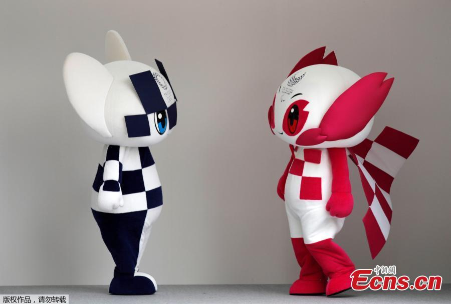 Tokyo 2020 Olympic Games mascot Miraitowa and Paralympic mascot Someity  stand on stage during the mascots\' debut in Tokyo, Japan, July 22, 2018. (Photo/Agencies)