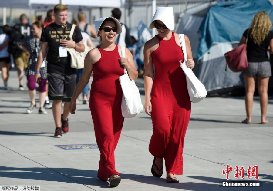 Fernanda Ambrosious, left, and Cristin Eleni, of San Diego, dress as characters from \