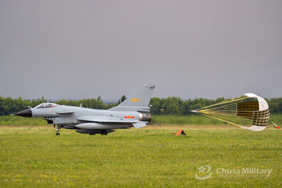 A J-10A fighter jet attached to the Chinese PLA Air Force deploys its drogue parachute to slow itself after landing at the airport on July 21. All aircraft of the PLA Air Force to participate in the \