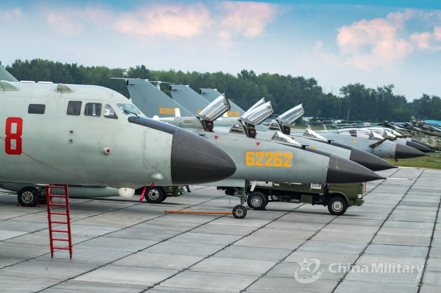 Multi-type aircrafts attached to the PLA Air Force sit on sit abreast on the flightline. All aircraft of the PLA Air Force to participate in the \