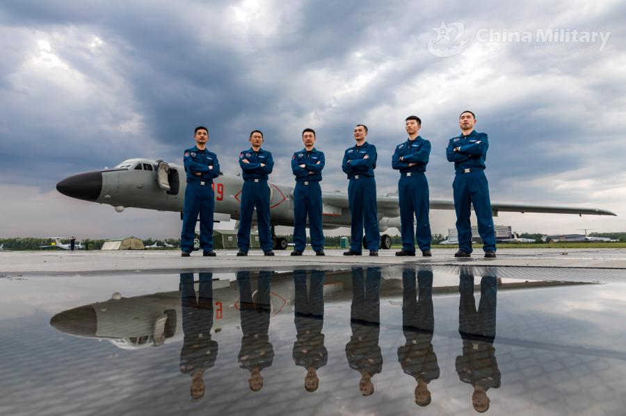 Pilots assigned to the Chinese PLA Air Force stand in front of an H-6K bomber on July 20. All aircraft of the PLA Air Force to participate in the \