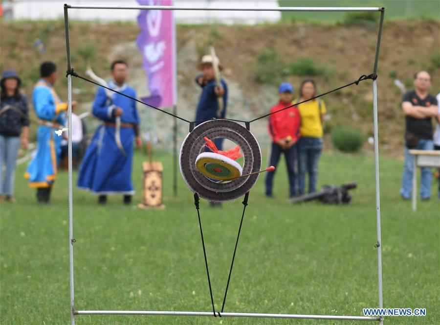 Herdsmen take part in an archery contest during Baima Festival held in West Ujimqin Banner, north China\'s Inner Mongolia Autonomous Region, July 21, 2018. The two-day event is a mass traditional Mongolian festival mainly filled with sports events. (Xinhua/Liu Lei)