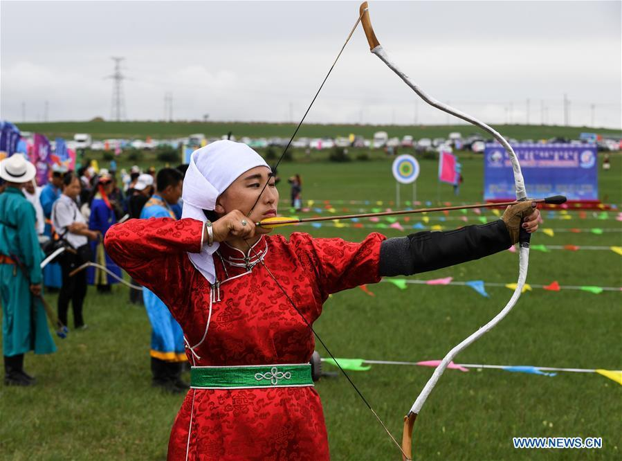 A woman takes part in an archery contest during Baima Festival held in West Ujimqin Banner, north China\'s Inner Mongolia Autonomous Region, July 21, 2018. The two-day event is a mass traditional Mongolian festival mainly filled with sports events. (Xinhua/Liu Lei)