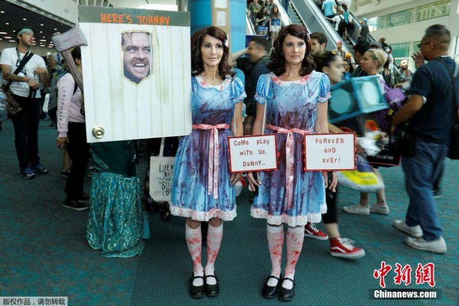 Samantha Sherman (R) and Gayle Hooker dressed as the twins from the movie The Shinning attends opening day of pop culture convention Comic-Con in San Diego, California, U.S., July 19, 2018. (Photo/Agencies)