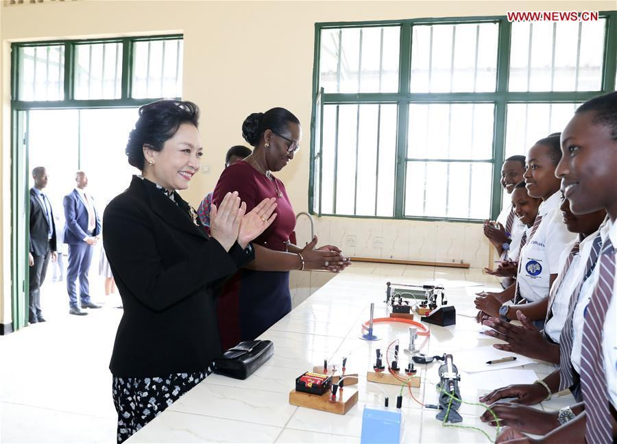 Peng Liyuan, wife of Chinese President Xi Jinping, accompanied by Jeannette Kagame, wife of Rwandan President Paul Kagame, visits the FAWE Girls\' School in north Kigali, Rwanda, July 23, 2018. (Xinhua/Ding Lin)