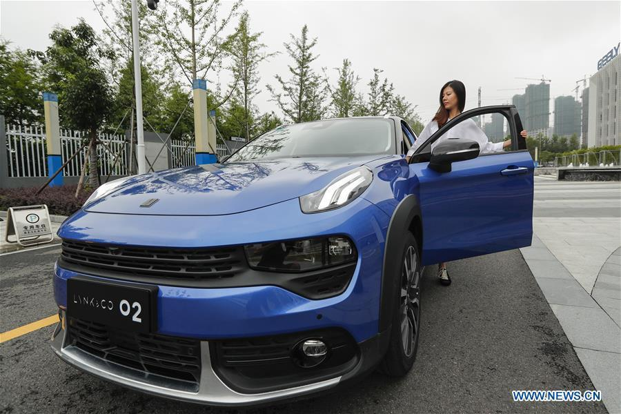 A visitor takes a test drive of Lynk & Co 02 at a research and development center of Geely Auto in east China\'s Zhejiang Province, July 3, 2018. This year marks the 40th anniversary of China\'s reform and opening-up policy. (Xinhua/Shen Bohan)