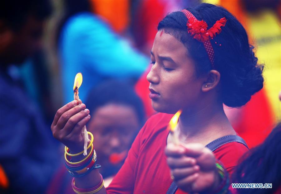 A Hindu girl offers prayers on Shrawan Somvar at Pashupatinath Temple in Kathmandu, Nepal, July 23, 2018. Mondays in the holy month of Shrawan are considered auspicious for Hindu women as they fast and offer prayers to Lord Shiva for the long and prosperous life for their husbands. (Xinhua/Sunil Sharma)