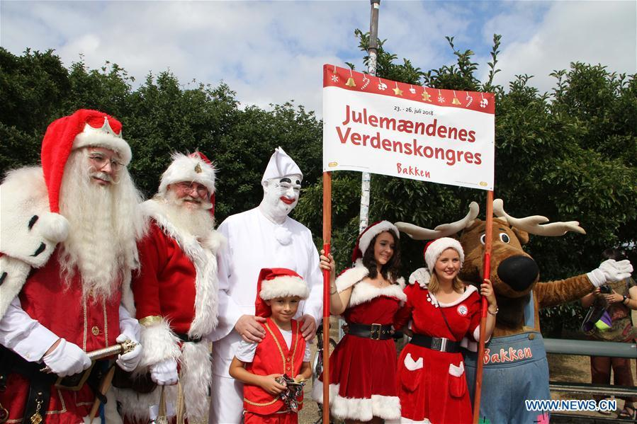 People dressed as Santa Claus pose for photos in Copenhagen, capital of Denmark, on July 23, 2018. The 2018 World Santa Claus Congress kicked off at Bakken amusement park, north of Copenhagen, on Monday. Some 100 Santa Claus from around the globe gathered here in the Danish capital city during the four-day event. (Xinhua/Wu Bo)