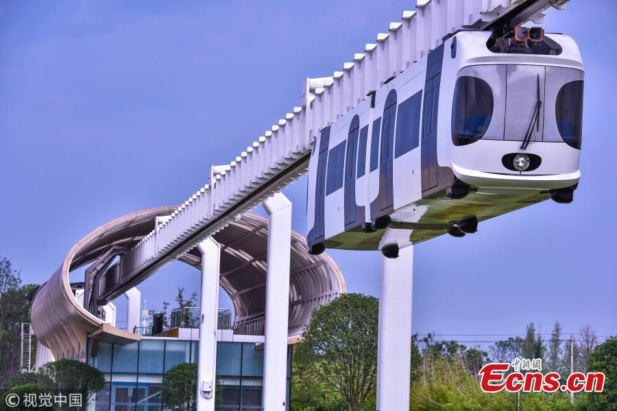 A suspension railway with carriages resembling pandas takes a trial run in Dayi County, Chengdu City, Southwest China's Sichuan Province, July 21, 2018. Chengdu has announced it will start construction on an elevated monorail linking Dayi Station on the Chengdu?Pujiang Intercity Railway and Anren Town in Dayi County. The 11.2-kilometer-long tourist railway will have a total investment of 2.178 billion yuan ($321 million), with construction expected to be complete in 17 months. Chengdu will experiment with the 'sky train' project while promoting its transportation network. (Photo/VCG)