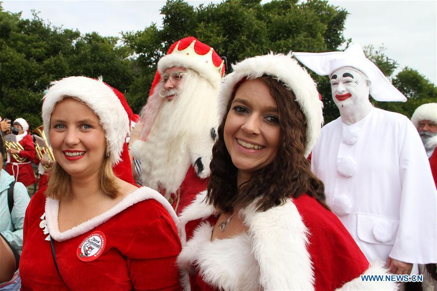 People dressed as Santa Claus gather in Copenhagen, capital of Denmark, on July 23, 2018. The 2018 World Santa Claus Congress kicked off at Bakken amusement park, north of Copenhagen, on Monday. Some 100 Santa Claus from around the globe gathered here in the Danish capital city during the four-day event. (Xinhua/Wu Bo)