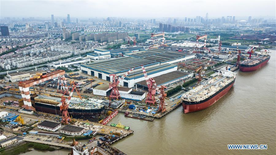 Photo taken on July 6, 2018 shows a shipyard of Nantong COSCO KHI Ship Engineering Co., Ltd. This year marks the 40th anniversary of China\'s reform and opening-up policy. (Xinhua/Shen Bohan)