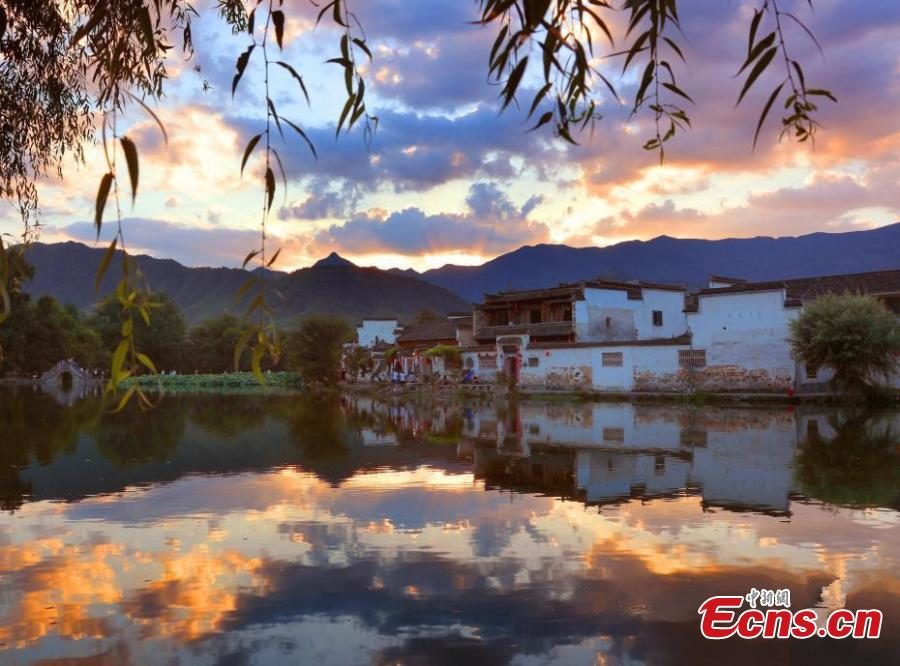 A spectacular view of Nanhu Lake in Hongcun Village at sunset in Huangshan City, Anhui Province. The two traditional villages of Xidi and Hongcun were inscribed as UNESCO World Heritage sites in 2000 as their unique landscapes, architectural forms, decorative features, and construction techniques all retain the original features of Anhui villages from the 14th to 20th centuries. (Photo: China News Service/Shi Guangde)
