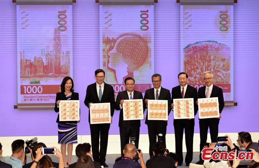 HKMA and bank officials, along with Financial Secretary Paul Chan Mo-po, unveil the notes at a press conference in Hong Kong, July 24, 2018. Hong Kong's new banknotes will have six advanced security features to prevent counterfeiting, and will showcase the city's rich natural and cultural heritage. (Photo: China News Service/Zhang Wei)