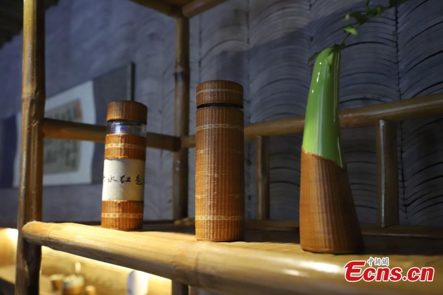 Bamboo weaving works are on display in Datong Ancient Town in Chishui City, Southwest China's Guizhou Province, July 24, 2018. The town has made efforts to creatively develop traditional handicrafts including bamboo weaving and oil-paper umbrella, which help lift locals out of poverty. (Photo: China News Service/Qu Honglun)