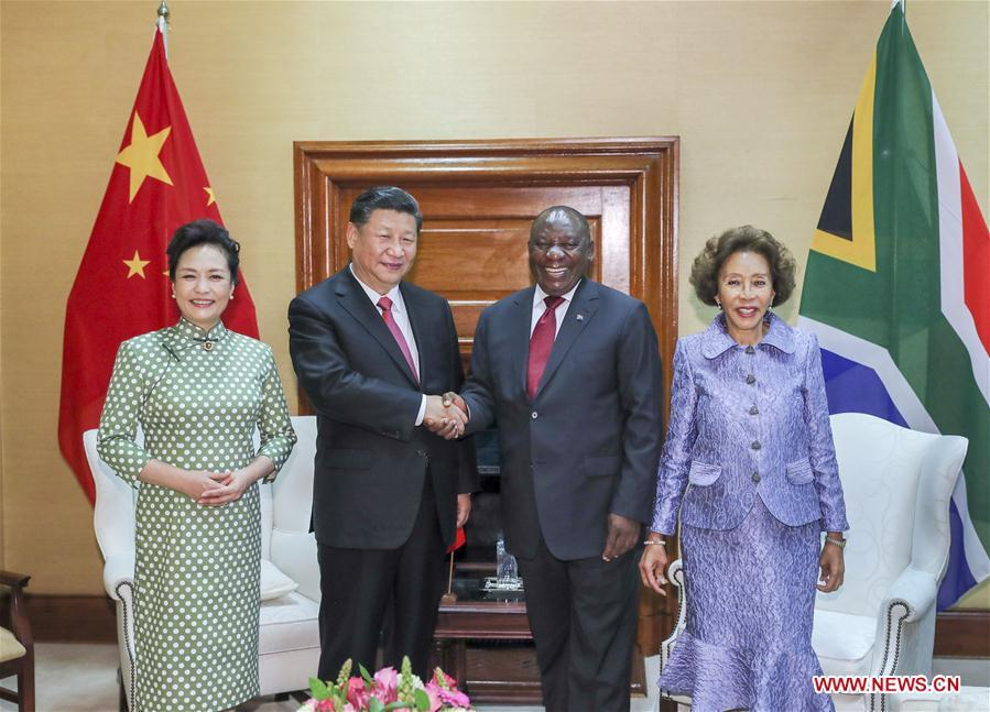 Chinese President Xi Jinping (2nd L) and his wife Peng Liyuan (1st L) pose for photos with South African President Cyril Ramaphosa (2nd R) and his wife Tshepo Motsepe ahead of the two leaders\' talks in Pretoria, South Africa, July 24, 2018. (Xinhua/Xie Huanchi)