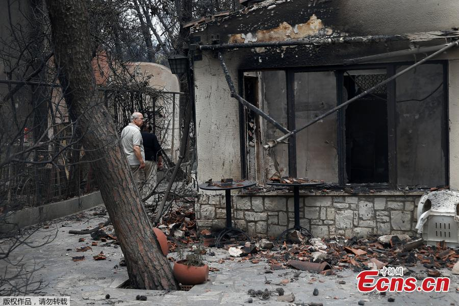 "A local looks at his burnt house following a wildfire at the village of Mati, near Athens, Greece, July 24, 2018. Greece's prime minister told of the ""unspeakable tragedy"" the country faced after at least 74 people were killed by wildfires that swept through a resort, trapping people in cars and on the edge of cliffs as others were forced to jump off to survive. (Photo/Agencies)"