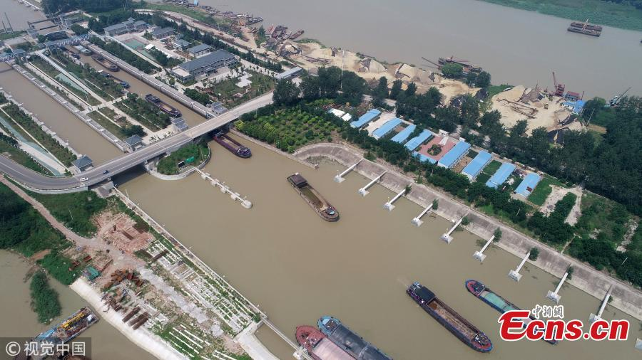 An aerial view of ships waiting to pass a navigation lock in Hongze Lake, Huaian City, East China's Jiangsu Province, July 25, 2018. Thousands of ships had to berthed in port for days due to tropical storm Ampil. (Photo/VCG)