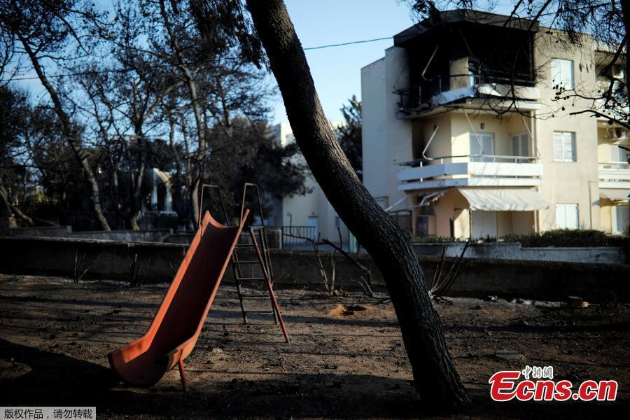 A slide is seen in a burnt playground following a wildfire at the village of Mati, near Athens, Greece, July 25, 2018. (Photo/Agencies)