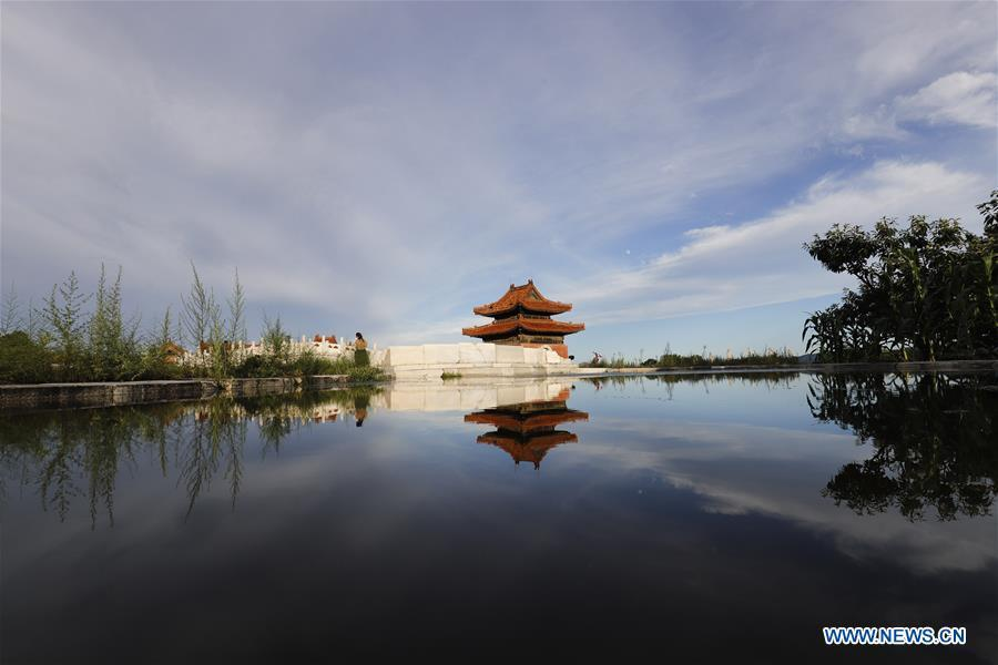 Photo taken on July 24, 2018 shows a stele tower and its water reflection at Dongling Imperial Mausoleum scenic spot in Zunhua City, north China\'s Hebei Province. (Xinhua/Liu Mancang)