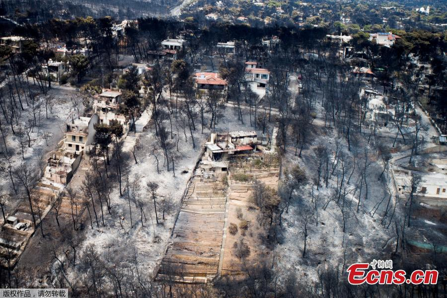 Burnt houses are seen following a wildfire at the village of Mati, near Athens, Greece, July 25, 2018. (Photo/Agencies)