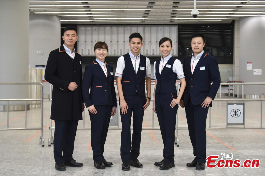 Photo taken on July 26, 2018 shows staff members in their new uniforms at the West Kowloon Station of the Guangzhou-Shenzhen-Hong Kong Express Rail Link that will open in September. The Hong Kong section of the Express Rail Link runs from the station in West Kowloon north to the Shenzhen-Hong Kong border, where it connects with the mainland section. (Photo: China News Service/Sheung Man Mak)
