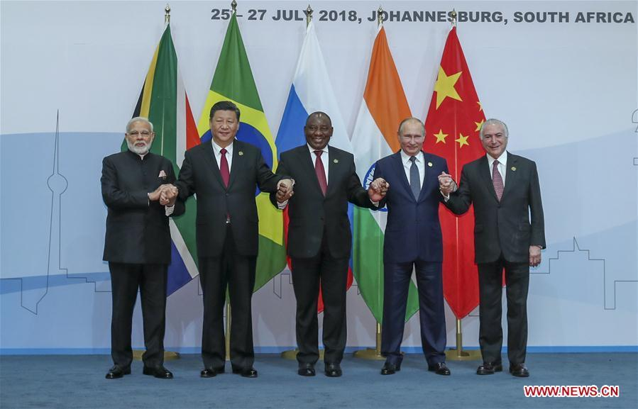 Chinese President Xi Jinping (2nd L), Brazilian President Michel Temer (1st R), Russian President Vladimir Putin (2nd R), Indian Prime Minister Narendra Modi (1st L) and South African President Cyril Ramaphosa pose for a group photo during the Plenary Session of the 10th BRICS summit in Johannesburg, South Africa, July 26, 2018. (Xinhua/Xie Huanchi)
