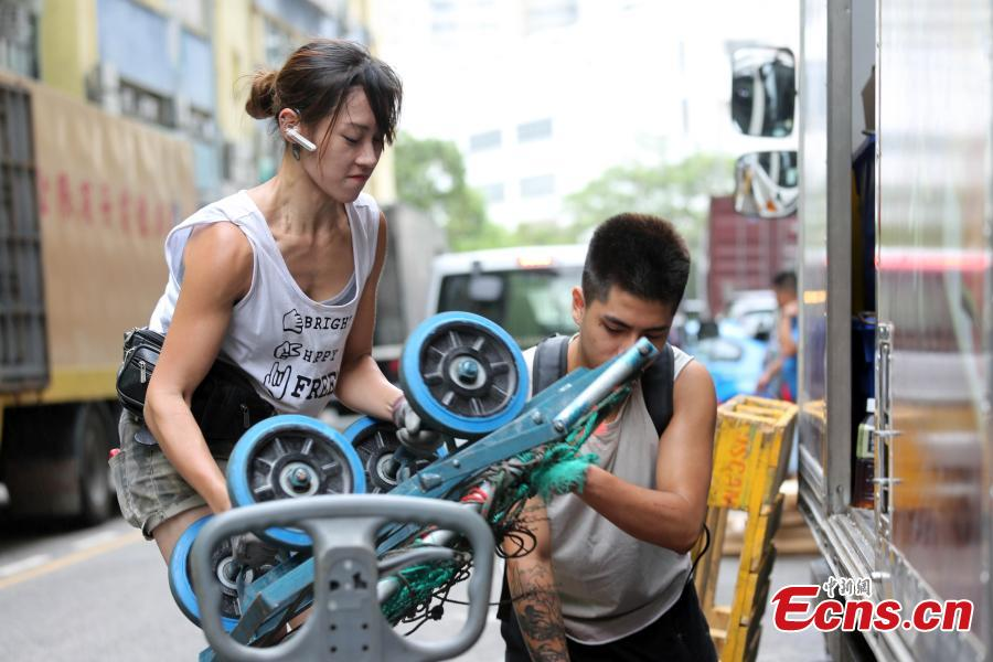 Zhu works in Ng Fong Street in San Po Kong, Hong Kong. Zhu became an internet sensation last year when photos of her working as a porter were shared online. Zhu, 30, transports goods for a local grocery store. (Photo: China News Service/Hong Shaokui)