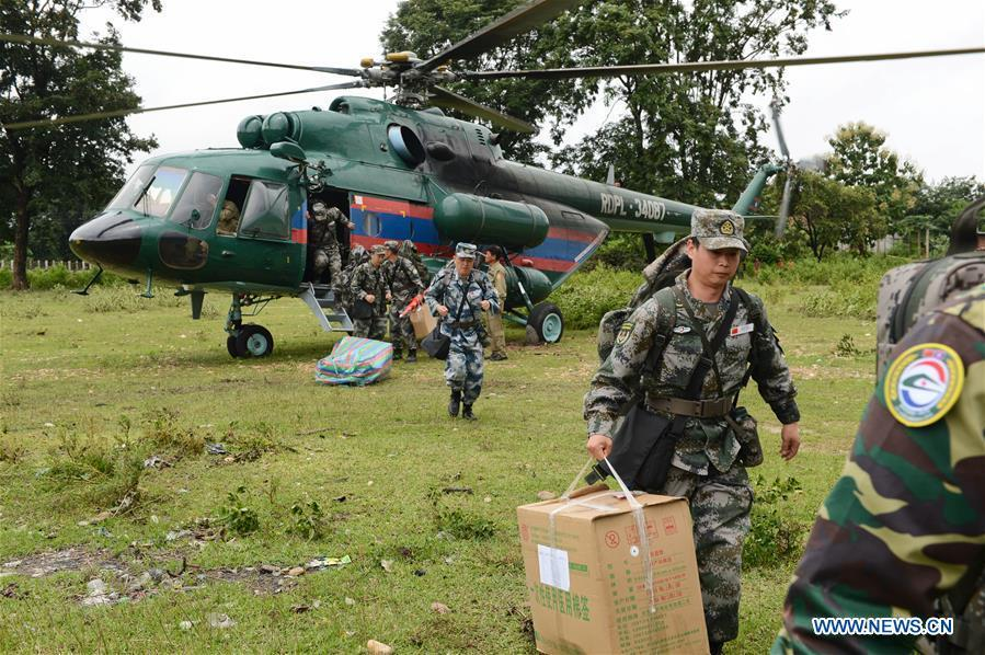 A Chinese People\'s Liberation Army (PLA) medical team arrive at the flooded-area in Attapeu, Laos, July 26, 2018. A medical contingent from the Chinese People\'s Liberation Army (PLA), which is on the \