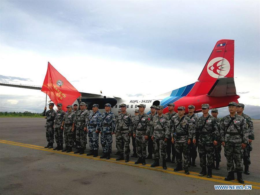 A Chinese People\'s Liberation Army (PLA) medical team arrive at the airport in Attapeu, Laos, July 25, 2018. A medical contingent from the Chinese People\'s Liberation Army (PLA), which is on the \